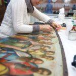 Реставратор станковой живописи А.Марченко работает надиконой изиконостаса церкви Рождества Христова